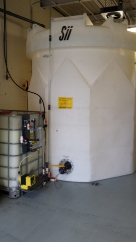 water treatment tank and tote setup